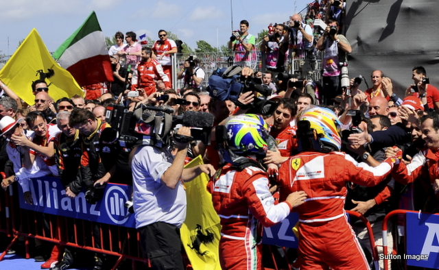 Alonso and Massa get a huge welcome from the team in parc ferme