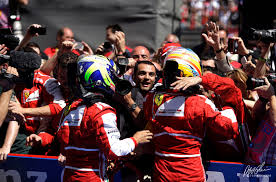 Alons and Massa get a huge welcome from the team.