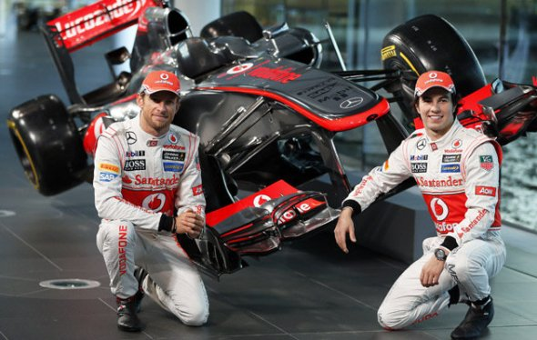 Mclaren's New 2013 driver line-up Jenson Button and Sergio Perez and everyone is all smiles...