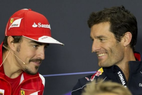 Alonso finishes third at days end. He is smiling here have a chat with Webber, but he can't be happy with today race pace.