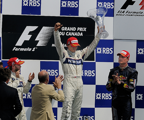 Robert Kubica stands atop the podium - I was a first a Polish driver and it was BMW's first win as a new constructor.