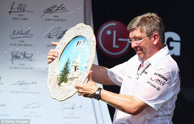 Ross Brawn accepting the Team trophy in Hungary. Has his team finally gotten on top of its tire issue.