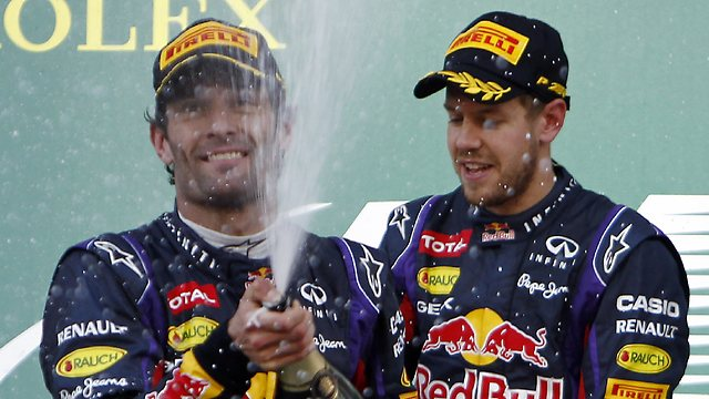 Mark Webber looks kinda happy here, but his comments post race tell a different story. Was his race compromised to aid Vettel or did he just not get the job done?  Who knows...